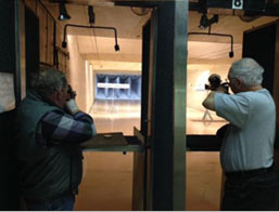 Two men shooting air pistol silhouettes